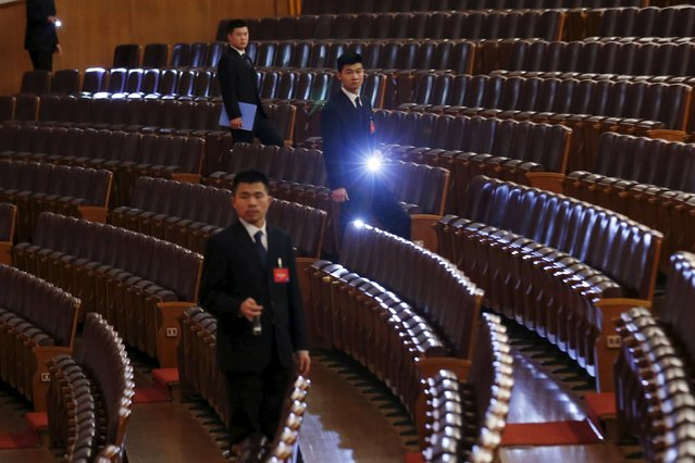 Security guards check after the third plenary session of the National People's Congress (NPC) at the Great Hall of the People, in Beijing, China, March 13, 2016. (Photo by Kim Kyung-hoon/Reuters)