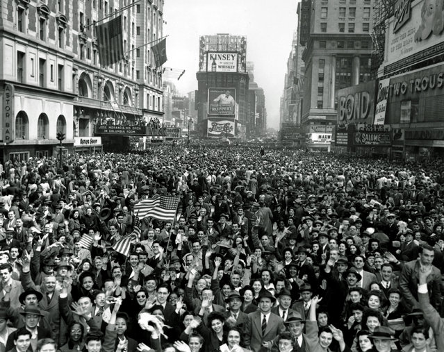 Looking north from 44th Street, New York's Times Square is packed Monday, May 7, 1945, with crowds celebrating the news of Germany's unconditional surrender in World War II. (Photo by Tom Fitzsimmons/AP Photo)