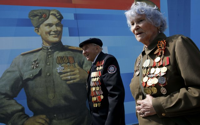 World War Two veterans arrive to watch the Victory Day parade at Red Square in Moscow, Russia, May 9, 2015. (Photo by Sergei Karpukhin/Reuters)