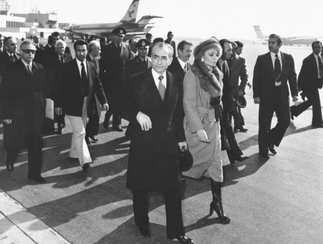 In this January 16, 1979 file photo, Shah Mohammad Reza Pahlavi and Empress Farah walk on the tarmac at Mehrabad Airport in Tehran, Iran, to board a plane to leave the country. Forty years ago, Iran's ruling shah left his nation for the last time and an Islamic Revolution overthrew the vestiges of his caretaker government. The effects of the 1979 revolution, including the takeover of the U.S. Embassy in Tehran and ensuing hostage crisis, reverberate through decades of tense relations between Iran and America. (Photo by AP Photo/File)