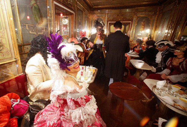 Revellers are seen in the Caffe Florian coffee shop in Saint Mark's Square during the Venice Carnival, Italy February 17, 2017. (Photo by Alessandro Bianchi/Reuters)