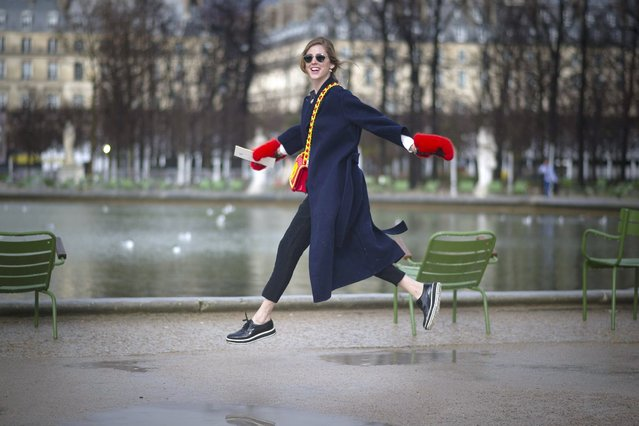Chiara Ferragni seen wearing Louis Vuitton coat a bag from Moschino by Jeremy Scott and gloves from MSGM outside the Elie Saab show on March 3, 2014 in Paris, France. (Photo by Timur Emek/Getty Images)