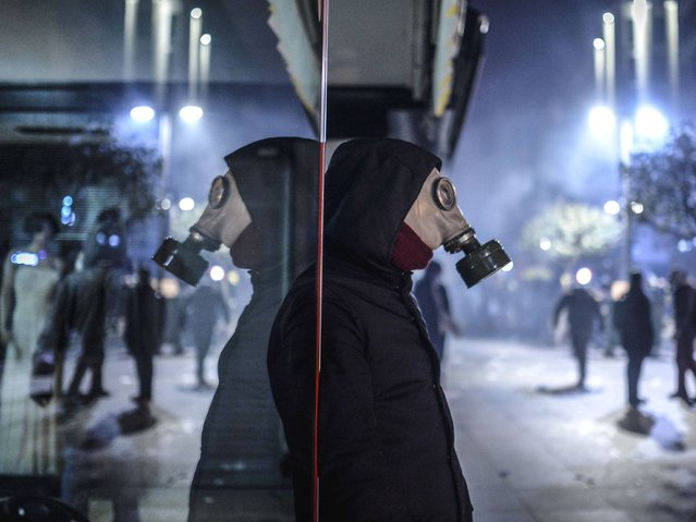 A protester wearing a gas mask stands during clashes with police in Istanbul. (Photo by Bulent Kilic/AFP Photo)
