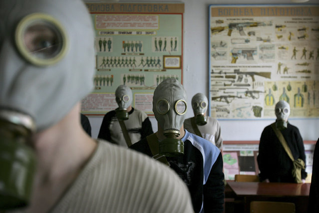 Ukrainian students try on gas masks as part of a safety drill in a school in Rudniya, just outside the Chernobyl contamination zone, Monday, April 3, 2006. (Photo by Oded Balilty/AP Photo)