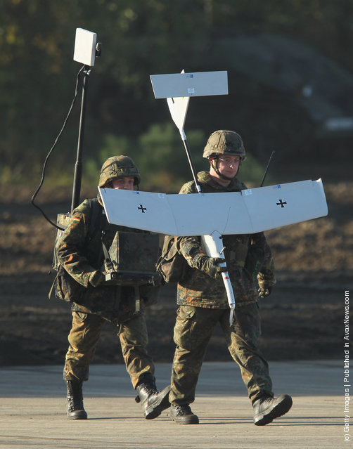 Soldiers hold an Aladin remote controlled reconaissance aircraft of the German Bundeswehr
