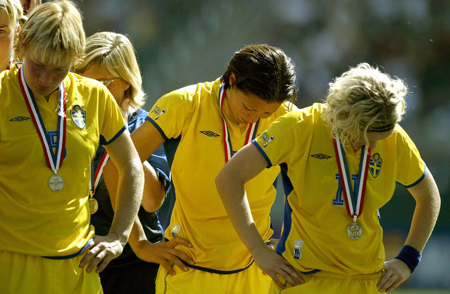 Kristin Bengtsson #5, Jane Toernqvist #3 and Victoria Svensson #11 of Sweden look down after losing to Germany 2-1 in overtime of the FIFA Women''s World Cup Final on October 12, 2003 at the Home Depot Center in Carson, California. (Photo by Jonathan Ferrey/Getty Images)