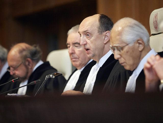 "Judge Peter Tomka, center, president of the International Court of Justice, delivers its verdict in The Hague, Netherlands, Monday March 31, 2014. ""The court concludes that the special permits granted by Japan for the killing, taking, and treating of whales ... are not for purposes of scientific research"", Tomka said. The International Court of Justice is ruling Monday on Australia's challenge against Japan for whaling in Antarctic waters. (Photo by Phil Nijhuis/AP Photo)"