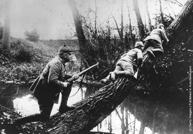 German sharpshooters move to a position near the front line, during the fighting near the Aisne River, 1914