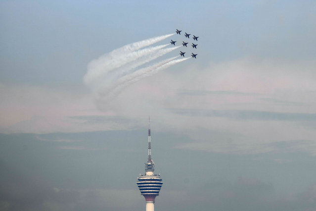The Black Eagles, the aerobatic team of T-50 jets belonging to South Korea' s air force, fly in formation above the Kuala Lumpur Tower during a flypast in Kuala Lumpur on March 29, 2017. (Photo by Mohd Rasfan/AFP Photo)