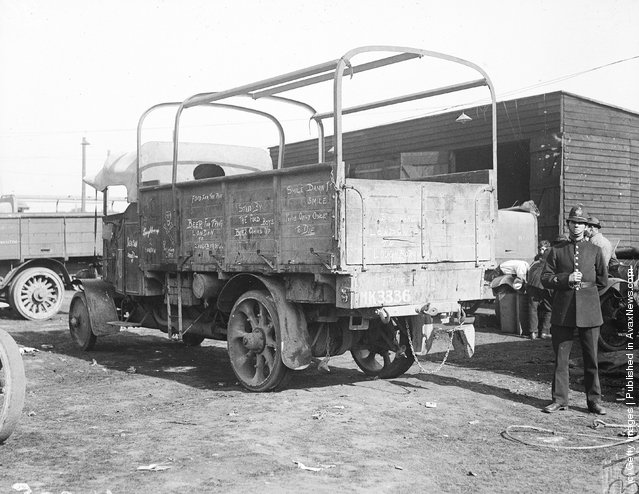 1919: A policeman standing guard over a lorry at a milk depot in Hyde Park during the railway strike