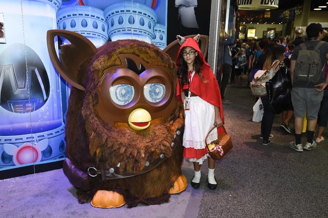 Natalia Knapp poses with a Furbaca on display on Preview Night at Comic-Con International held at the San Diego Convention Center Wednesday July 8, 2015 in San Diego. (Photo by Denis Poroy/Invision/AP Photo)