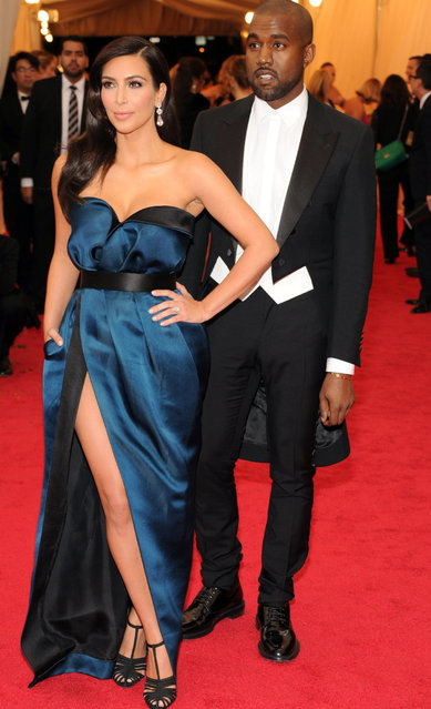 "Kim Kardashian and Kanye West attend  the ""Charles James: Beyond Fashion"" Costume Institute Gala at the Metropolitan Museum of Art on May 5, 2014 in New York City. (Photo by Kevin Mazur/WireImage)"