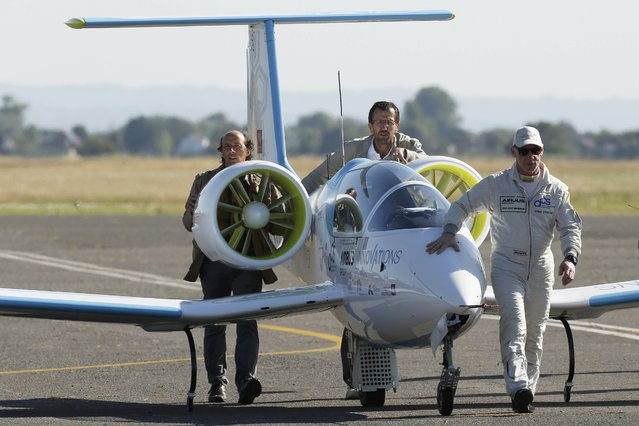 Pilot and designer Didier Esteyne (R) prepares to take off in the Airbus Group E-Fan electric aircraft, during an attempt to fly across the channel from Lydd Airport in southeast England, Britain July 10, 2015. (Photo by Luke MacGregor/Reuters)