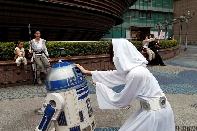 "Fans dressed as the characters from ""Star Wars"" react during Star Wars Day in Taipei, Taiwan on May 4, 2017. (Photo by Tyrone Siu/Reuters)"