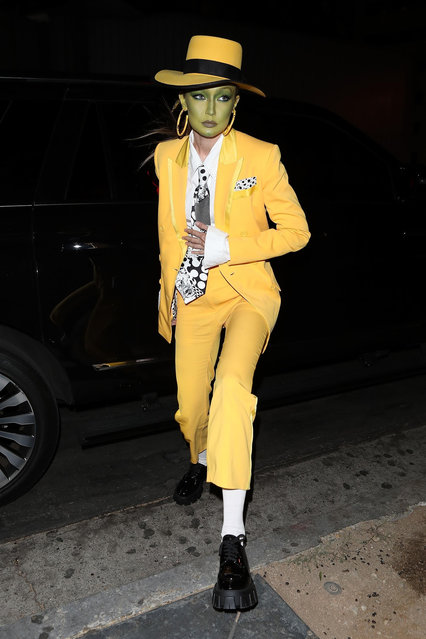 """Gigi Hadid arrives with some model friends at Kendall Jenner's Halloween party in Beverly Hills, CA. on October 31, 2019 dressed as Jim Carrey's character in """"The Mask"""". (Photo by Backgrid USA)"""