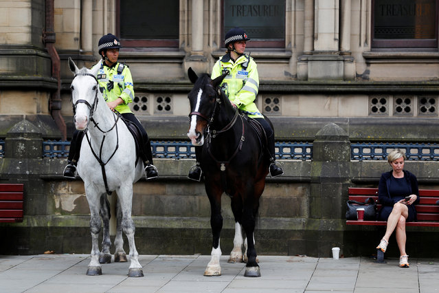 Mounted police officers wait outside the townhall in Manchester, Britain May 24, 2017. (Photo by Darren Staples/Reuters)