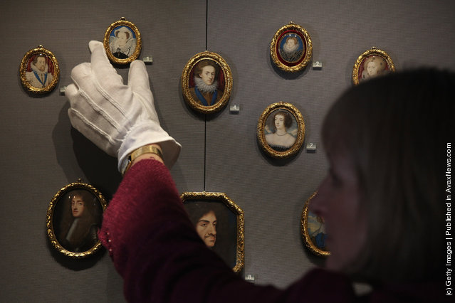 Curator Deborah Clarke, holds a Minature of Mary, Queen of Scots, part of the Royal Collection on display at the Queens Gallery