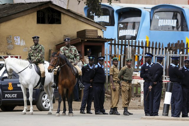 Police officers guard the route as U.S. President Barack Obama travels to participate in a bilateral meeting with Kenya's President Uhuru Kenyatta at the State House in Nairobi July 25, 2015. (Photo by Jonathan Ernst/Reuters)