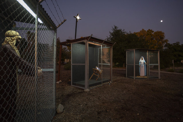 A Christmas nativity scene depicts Jesus, Mary, and Joseph separated and caged, as asylum seekers detained by U.S. Immigration and Customs Enforcement, at Claremont United Methodist Church on December 9, 2019 in Claremont, California. The church hopes the display will prompt viewers to ask themselves what the family would face today if seeking refuge in the U.S. as they did when fleeing Nazareth to Egypt to escape capture by the forces of King Herod. The Claremont United Methodist Church has worked to assist asylum seekers at the U.S.-Mexico border. (Photo by David McNew/Getty Images)