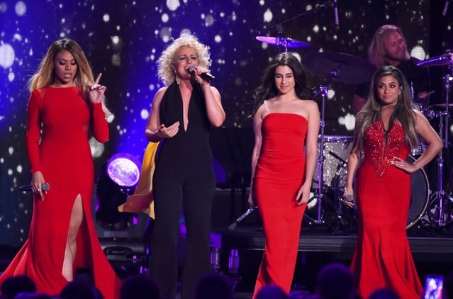 Singer Cam, with Fifth Harmony (in red), perform a medley at the 2016 CMT Music Awards in Nashville, Tennessee, U.S. June 8, 2016. (Photo by Harrison McClary/Reuters)