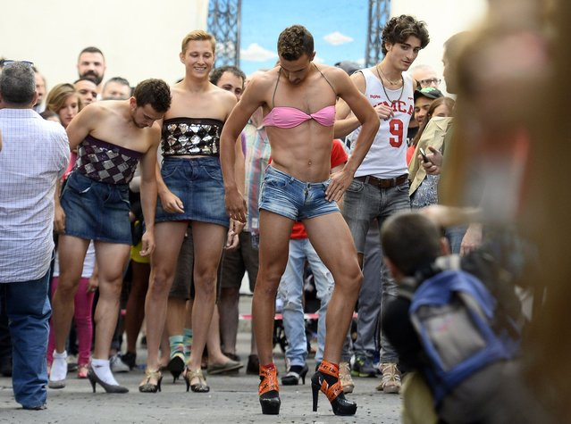 Participants take part in a high-heel race at a Gay Pride party in the central neighborhood of Chueca in Madrid on July 3, 2014. (Photo by Gerard Julien/AFP Photo)