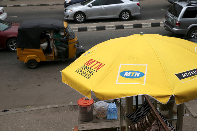 The logo of MTN telecommunication company is seen printed on a umbrella at a call point along a road in Lagos, Nigeria November 16, 2015. Picture taken November 16, 2015. (Photo by Akintunde Akinleye/Reuters)