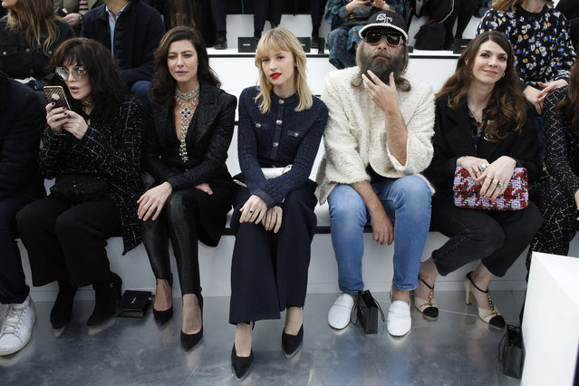 From left, actresses Isabelle Asjani, Anna Mouglalis, singer Angele, Sebastien Tellier and Amandine de la Richardiere pose for photographers prior to the Chanel fashion collection during Women's fashion week Fall/Winter 2020/21 presented Tuesday, March 3, 2020 in Paris. (Photo by Thibault Camus/AP Photo)