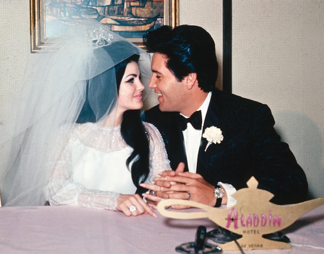 In this May 1, 1967, file photo, singer Elvis Presley and his bride, the former Priscilla Beaulieu, appear at the Aladdin Hotel in Las Vegas, after their wedding. Presley, 32, and Beaulieu, 21, both from Memphis, Tenn., met while he was stationed in Germany with the U.S. Army.  (Photo by AP Photo)