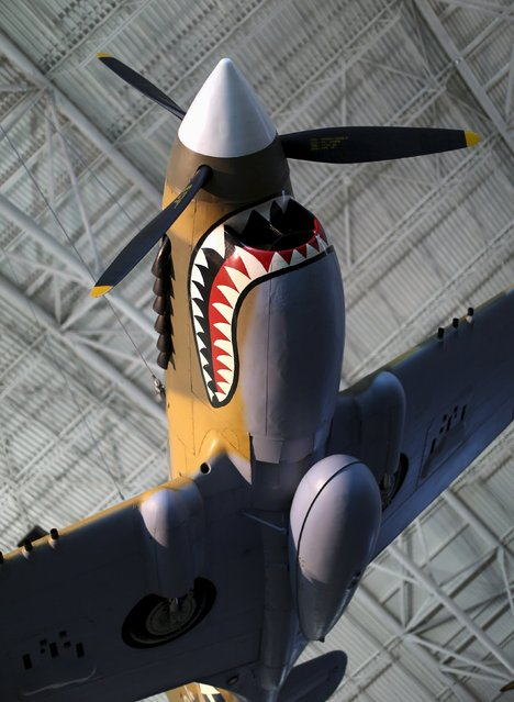 A Curtis P-40 Flying Tiger WWII vintage fighter aircraft is seen at the Udvar-Hazy Smithsonian National Air and Space Annex Museum in Chantilly, Virginia August 28, 2015. (Photo by Gary Cameron/Reuters)