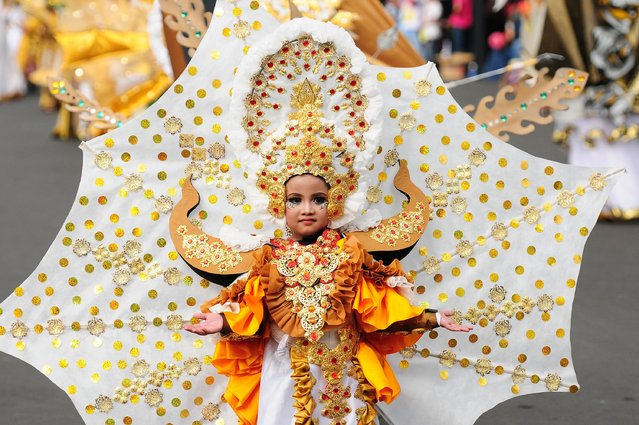 A model wears a Mahabharata costume in the kids carnival during The 13th Jember Fashion Carnival 2014 on August 21, 2014 in Jember, Indonesia. (Photo by Robertus Pudyanto/Getty Images)