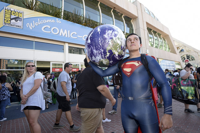 Bersain Gutierrez, dressed as Superman, poses in front of the convention center before Preview Night at Comic-Con International held at the San Diego Convention Center Wednesday July 20, 2016, in San Diego. (Photo by Denis Poroy/Invision/AP Photo)