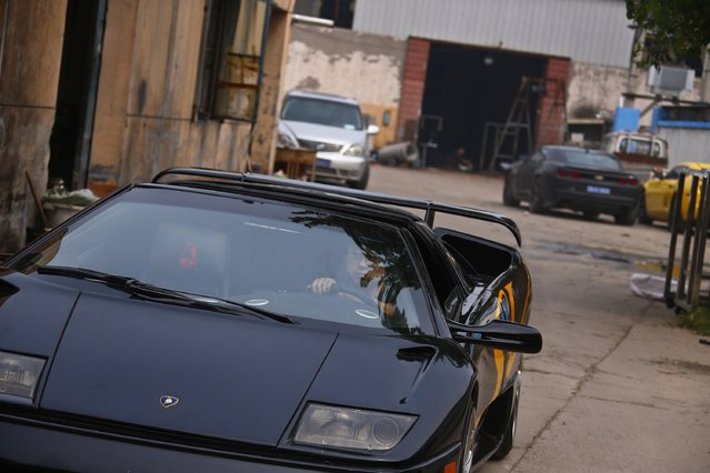 Wang Yu drives a handmade replica of Lamborghini Diablo during a test drive outside a garage on the outskirts of Beijing, August 21, 2014. (Photo by Petar Kujundzic/Reuters)