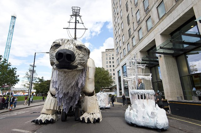 A general view of the giant polar bear puppet outside the Shell Building on September 2, 2015 in London, England. As part of the protest, 64 activists and puppeteers manoeuvred a giant polar bear puppet the size of a double decker bus to rest just metres away from Shell's front entrance. It's intended the polar bear titan will remain fixed there until Shell's Arctic drilling window ends later this month. (Photo by Ben Pruchnie/Getty Images)