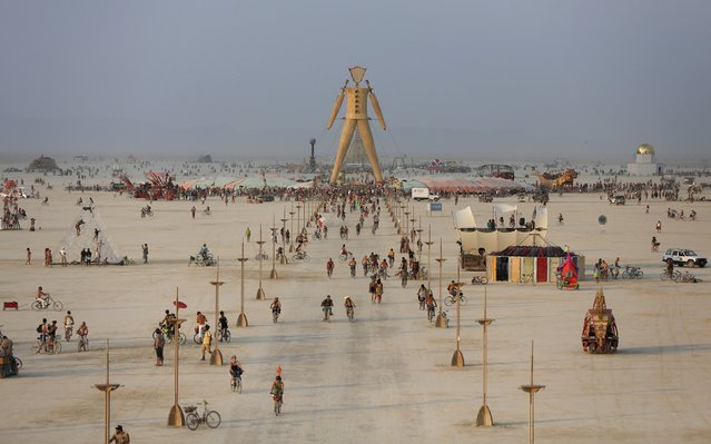 "A view of the Playa and the Man during the Burning Man 2014 ""Caravansary"" arts and music festival in the Black Rock Desert of Nevada, August 28, 2014. (Photo by Jim Urquhart/Reuters)"