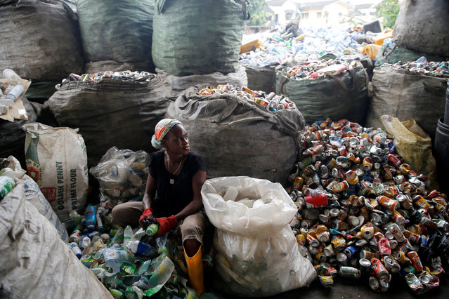 A woman sorts waste at the Wecycler waste recycling  centre in Ebutte Meta district in Lagos, Nigeria July 28, 2016. (Photo by Akintunde Akinleye/Reuters)