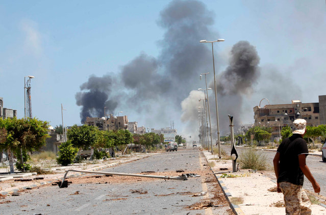 Smoke rises during a battle between Libyan forces allied with the U.N.-backed government and Islamic State fighters in neighborhood Number Two in Sirte, Libya August 16, 2016. (Photo by Ismail Zitouny/Reuters)