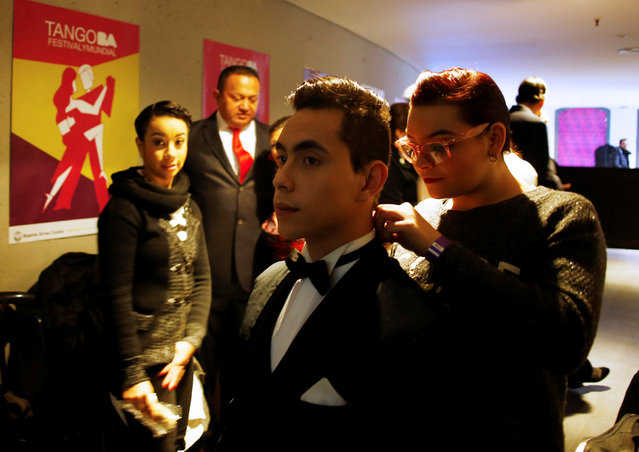 Contestants prepare backstage during the Salon Tango style qualifier round at the Tango World Championship in Buenos Aires, Argentina, August 22, 2016. (Photo by Enrique Marcarian/Reuters)