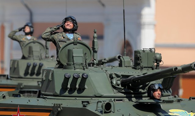 Russian servicemen drive military vehicles during the Victory Day Parade in Red Square in Moscow, Russia on June 24, 2020. The military parade, marking the 75th anniversary of the victory over Nazi Germany in World War Two, was scheduled for May 9 but postponed due to the coronavirus outbreak. (Photo by Maxim Shemetov/Reuters)