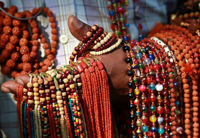 A vendor selling rosaries waits for customers at a market in Kochi, November 13, 2017. (Photo by Sivaram V/Reuters)