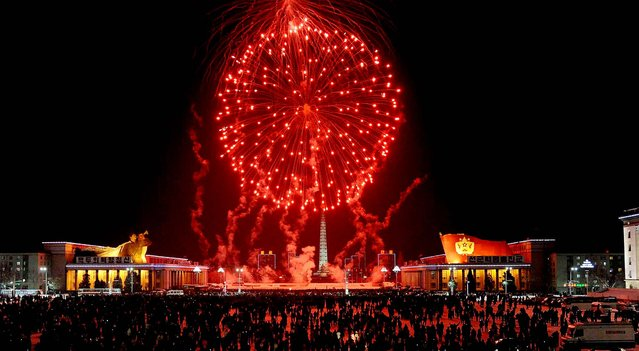 Fireworks explode over Kim Il Sung Square in Pyongyang, North Korea. (Photo by Kyodo News)