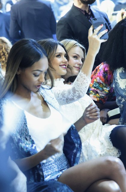 Jessica Alba takes a selfie at the H&M show as part of the Paris Fashion Week Womenswear Fall/Winter 2014-2015 at Le Grand Palais on February 26, 2014 in Paris, France. (Photo by Vittorio Zunino Celotto/Getty Images)