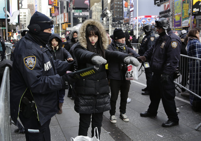 Spectators pass through security screening ahead of the New Year's Eve celebration in Times Square in New York, on Sunday, December 31, 2017. (Photo by Peter Morgan/AP Photo)