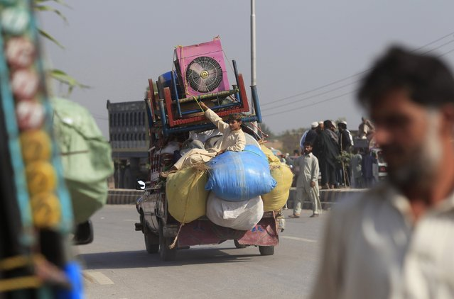 A man fleeing the military offensive against militants in the Khyber Agency, travels on a vehicle laden with his family's belongings on the outskirts of Peshawar in Pakistan's Khyber-Pakhtunkhwa province October 30, 2014. Twenty-nine people were killed and thousands of civilians forced to flee Pakistan's northwestern region of Khyber, the military said on Thursday, as it stepped up a two-week-old offensive against Taliban militants in the area. (Photo by Fayaz Aziz/Reuters)