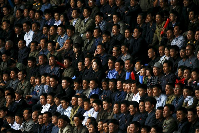 North Korean fans watch their team's preliminary 2018 World Cup and 2019 AFC Asian Cup qualifying soccer match against Philippines at the Kim Il Sung Stadium in Pyongyang October 8, 2015. (Photo by Damir Sagolj/Reuters)