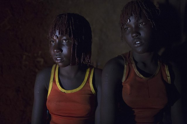Pokot girls wait together in a home before their circumcision ceremony in a village about 80 kilometres from the town of Marigat in Baringo County, October 16, 2014. (Photo by Siegfried Modola/Reuters)