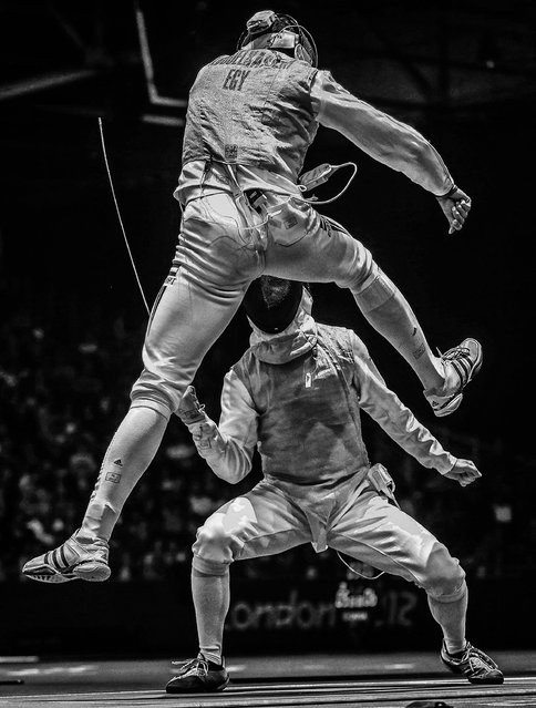 The 2nd prize Sports – Sports Action Stories by Sergei Ilnitsky, Russia, for European Pressphoto Agency, shows Alaaeldin Abouelkassem of Egypt (top) in action against Peter Joppich of Germany (C) during their Men's Foil Individual Round16 match for the London 2012 Olympic Games in London, Britain, July 31, 2012. (Photo by Sergei Ilnitsky/European Pressphoto Agency)