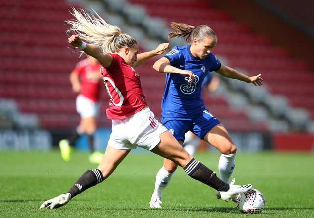 Kirsty Smith of Manchester United Women tackles Guro Reiten of Chelsea Women during the Barclays FA Women's Super League at Leigh Sports Village on September 06, 2020 in Leigh, England. (Photo by James Gill – Danehouse/Getty Images)