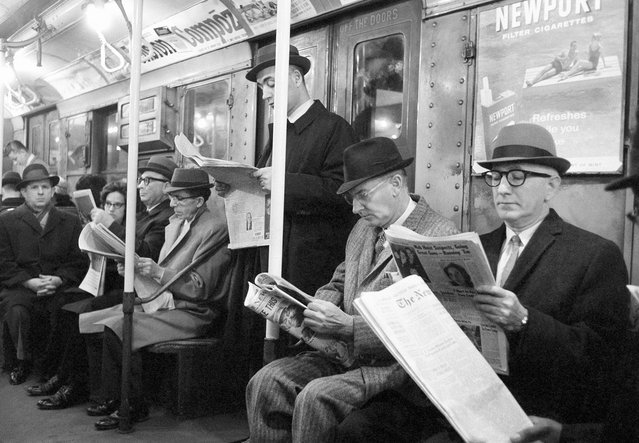 Riders read their morning newspapers on New York's subway en route to work, on April 1, 1963 after the end of the city's 114-day newspaper strike. (Photo by Jacob Harris/AP Photo)