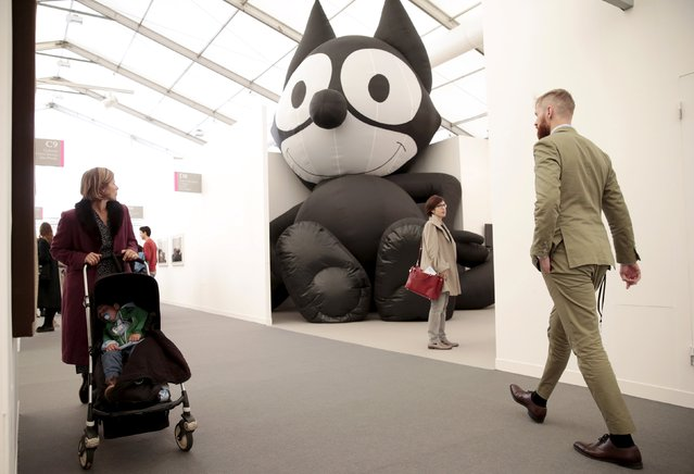 "Visitors walk past ""Inflatable Felix"" by Mark Leckey at the Frieze Art Fair in London, Britain October 14, 2015. (Photo by Suzanne Plunkett/Reuters)"