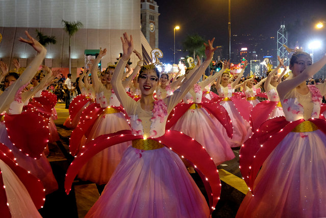 Dancers from China's Hainan perform during a parade to celebrate the Year of the Dog in Hong Kong, China February 16, 2018. (Photo by Bobby Yip/Reuters)